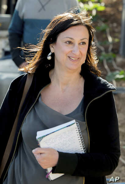 This photo taken on April 4, 2016 shows Daphne Galizia, the Maltese investigative journalist who exposed her island nation's links with the so-called Panama Papers. Galizia was killed on Monday, Oct. 16, 2017, when a bomb destroyed her car as she w...