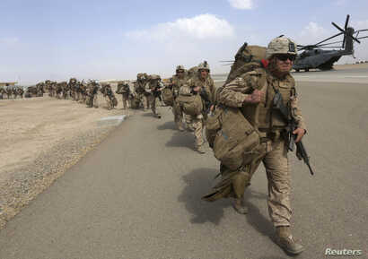 U.U.S. Marines prepare to depart at the end of operations for Marines and British combat troops in Helmand, Afghanistan, Oct. 27, 2014.