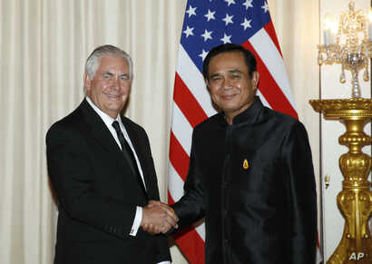 U.S. Secretary of State Rex Tillerson, left, shakes hands with Thailand's Prime Minister Prayut Chan-o-cha during a meeting at the Government House in Bangkok, Thailand, Aug. 8, 2017. Tillerson is on an official visit to Thailand aimed at strengtheni...