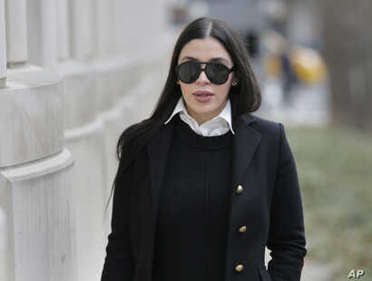 """Emma Coronel Aispuro, wife of Joaquin """"El Chapo"""" Guzman, arrives at federal court in New York, Dec. 6, 2018, for her husband's trial."""
