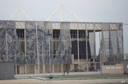 This Feb. 4, 2017, photo shows translucent tapestries created by Brazilian artist Adriana Varejao, falling from the exterior of Olympic Aquatic stadium inside Olympic Park in Rio de Janeiro, Brazil. The Olympic Park is now a cutting-edge ghost town.