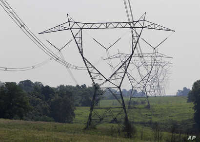 Electric lines extend over the hills of Owen County, near Owenton, Kentucky, July 22, 2011.