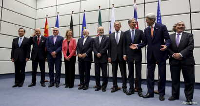 FILE - Group picture taken at the UN building in Vienna after Iran and six major world powers reached a nuclear deal.