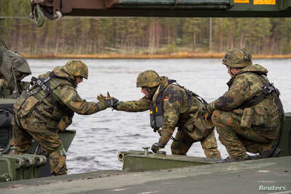 German soldiers from 2 Company Multinational Engineer Battalion of NATO's Very High Readiness Joint Task Force, man an M3 Amphibious Rig while conducting river crossing training during Exercise Trident Juncture 2018 at Camp Roedsmoen in Rena, Norwa...