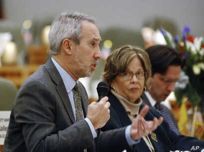 FILE - Democratic state Rep. Daymon Ely of Corrales, N.M., left, explains provisions of a bill he sponsored with Rep. Joy Garratt of Albuquerque, center, that would allow police or family members to seek court orders requiring people who are deemed t...