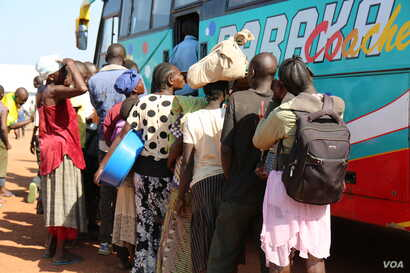 South Sudanese refugees wait to board a bus from the Kuluba collection point near the Busia border point for relocation to the Imvepi refugee settlement. Photo taken April 1 in Koboko, Uganda.