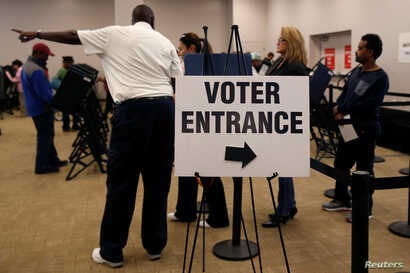 Voters wait in line to cast their ballots during early voting at the Franklin County Board of Elections in Columbus, in Columbus, Ohio.
