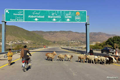 A Pakistani motorcyclist drives on a newly built Pakistan China Silk Road in Haripur, Pakistan, Dec. 22, 2017.
