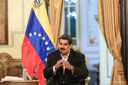 Venezuela's President Nicolas Maduro speaks during a meeting with members of the Venezuelan diplomatic corp after their arrival from the United States, at the Miraflores Palace in Caracas, Venezuela Jan. 28, 2019.
