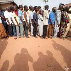 People wait to be registered at a polling station at Oyeleye in Ibadan, Nigeria.