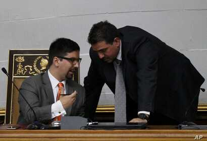 Venezuelan National Assembly Vice President Freddy Guevara, left, speaks with lawmaker Stalin Gonzalez during a session in Caracas,  Aug. 19, 2017.