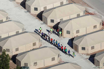 "Immigrant children, many of whom have been separated from their parents under a new ""zero tolerance"" policy by the Trump administration, are being housed in tents next to the Mexican border in Tornillo, Texas, June 18, 2018."