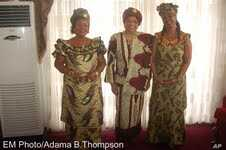 President Sirleaf (center) and Mrs. Quiwonkpa and Mrs. Doe