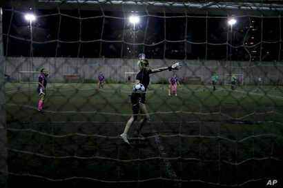 FILE - A goalkeeper throws the ball during a match in Buenos Aires, Argentina, Jan. 30, 2019.
