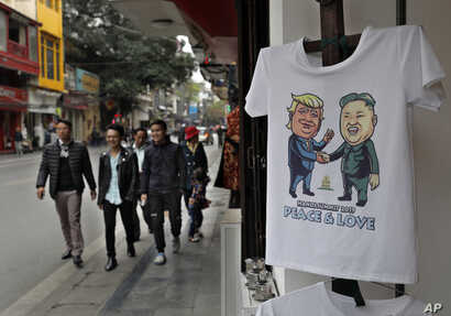 A T-shirt with images of U.S. President Donald Trump and North Korean leader Kim Jong Un is displayed at a tourist area in Hanoi, Vietnam, Feb. 24, 2019.