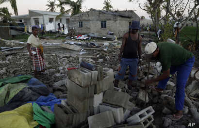 Members of a church salvages bricks from a damaged church building in Beira, Mozambique, Monday, March 25, 2019. The United Nations is making an emergency appeal for $282 million for the next three months to help Mozambique start recovering from the ...