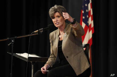 U.S. Sen. Joni Ernst, R-Iowa, reacts to a question during a town hall meeting, Sept. 21, 2017, in Charles City, Iowa.