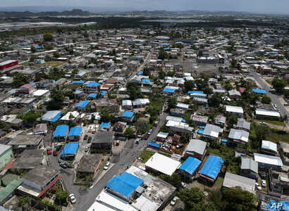 FILE - This June 18, 2018 photo shows an aerial view of the Amelia neighborhood in the municipality of Catano, east of San Juan, Puerto Rico.
