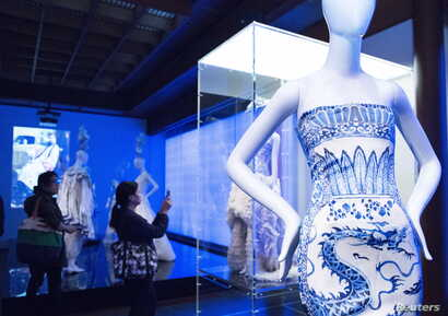 "Members of the media view selections for the Metropolitan Museum of Art Costume Institute Gala Benefit, ""China: Through the Looking Glass,"" during a media preview at the Metropolitan Museum of Art in New York, May 4 , 2015."