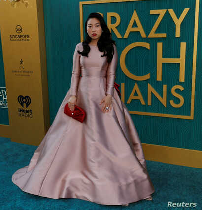 "Cast member Awkwafina poses at the premiere for ""Crazy Rich Asians"" in Los Angeles, California, U.S., August 7, 2018."