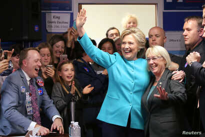 U.S. Democratic presidential nominee Hillary Clinton greets people at a campaign office in Seattle, Washington, Oct. 14, 2016.