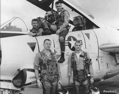 John McCain (Bottom R) poses with his U.S. Navy squadron in 1965.