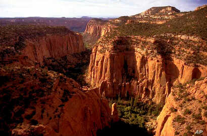 FILE - In this undated file photo, the Upper Gulch section of the Escalante Canyons within Utah's Grand Staircase-Escalante National Monument features sheer sandstone walls, broken occasionally by tributary canyons.