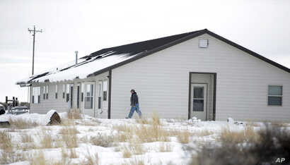 A members of the group occupying the Malheur National Wildlife Refuge headquarters, walks to one of it's buildings, near Burns, Oregon, Jan. 4, 2016.
