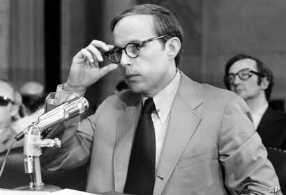 John Dean III, former White House aide in the Nixon Administration, adjusts his eyeglasses as he nears the end of reading his 245-page prepared statement before the Senate Watergate Committee in Washington, D.C., on June 25, 1973.