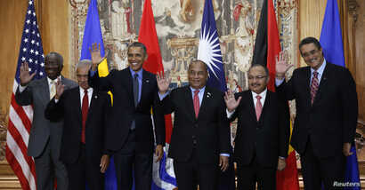 U.S. President Barack Obama poses for a family photo with leaders of island nations under threat by rising sea levels during the World Climate Change Conference 2015 (COP21) in Paris, Dec. 1, 2015.