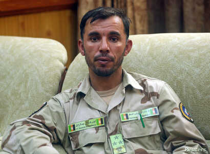 FILE - Gen. Abdul Razeq, who was killed in today's attack, is seen at his office in Kandahar province, Afghanistan, Aug. 4, 2016.