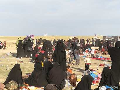 In the final weeks IS held a camp near Baghuz, Syria thousands of people evacuated the area, far more than any militaries or aid groups expected, pictured near Baghuz on March 10, 2019.