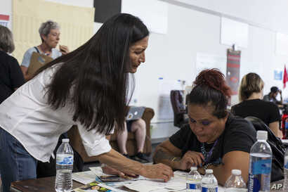 Deb Haaland, center, speaks with campaign organizers during the Democratic Primary elections at the Haaland headquarters in Albuquerque, New Mexico, June 5, 2018.