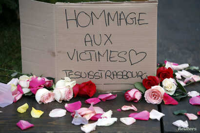 """A placard reads """"Tribute to the victims. I am Strasbourg"""", in Strasbourg, eastern France, Dec. 12, 2018."""