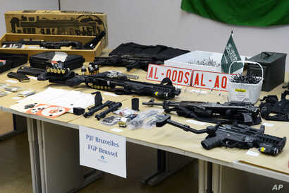 FILE - Belgian police displayed an arsenal they say was found in the home of a suspected terrorist whom they killed in a 2013 shootout in this March 27, 2013 photo.