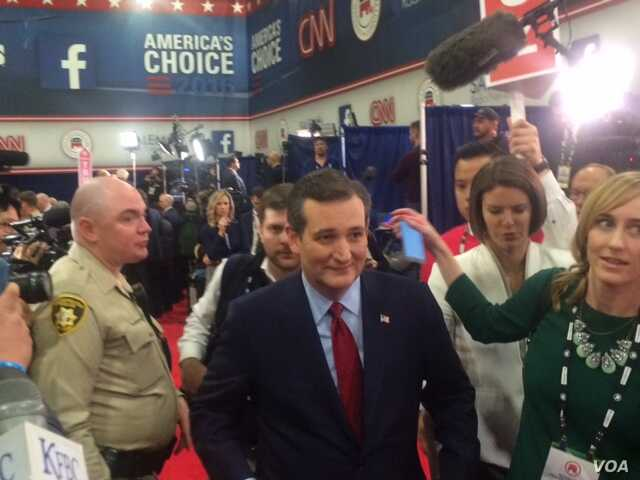 "Republican presidential candidate Ted Cruz walks through the ""Spin Room"" after the debate in Las Vegas, Nevada, Dec. 15, 2015. (Photo: E. Lee / VOA)"