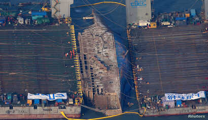 The sunken ferry Sewol is seen during its salvage operations at the sea off Jindo, South Korea, March 23, 2017.
