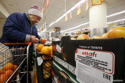 Grapefruit, imported from Turkey according to labels and product information on the box, are on sale at a grocery of the food retailer Dixy in Moscow, Dec. 1, 2015.