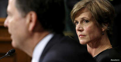 FILE -  Then-Deputy Attorney General Sally Quillian Yates (R) listens as FBI Director James Comey speaks during a Senate Judiciary Committee hearing in Washington.