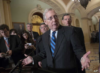 Senate Majority Leader Mitch McConnell, R-Ky., flanked by Sen. Cory Gardner, R-Colo., (L-Rear), and Sen. John Barrasso, R-Wyo. (R-Rear), tells reporters he has not seen a clear indication that Congress needs to step in and pass legislation to prevent...