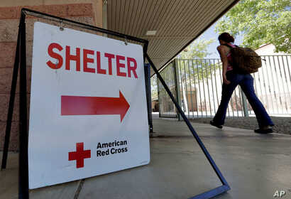 An evacuee from the Goodwin fire enters a Red Cross shelter, June 28, 2017, in Prescott Valley, Arizona.