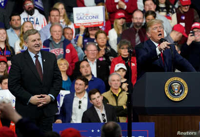 FILE - U.S. President Donald Trump speaks in support of Republican congressional candidate Rick Saccone during a Make America Great Again rally in Moon Township, Pennsylvania, March 10, 2018.