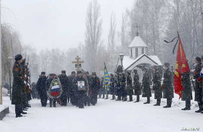 Honour guards stand at attention during the funeral ceremony of Oleg Peshkov, a Russian pilot of the downed SU-24 jet, at a cemetery in Lipetsk, Russia, December 2, 2015.