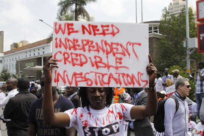 FILE - Kenyans human rights activists, lawyers and others hold a peaceful protest in Nairobi, July 4, 2016, against alleged pervasive killings and disappearances linked to police.