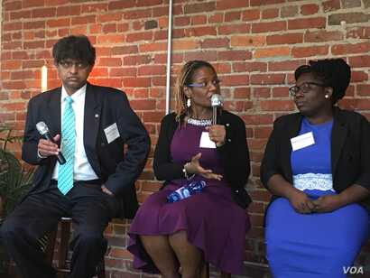 Three members of the 11-member U.S. Advisory Council on Human Trafficking discuss their first report, which was released Tuesday. (S. Herman/VOA)
