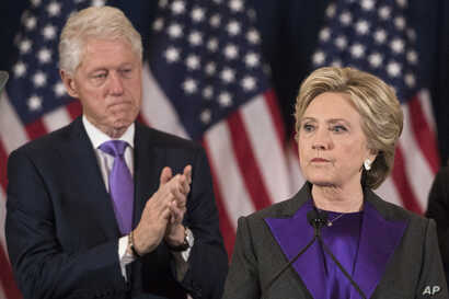 Former President Bill Clinton applauds as his wife, Democratic presidential candidate Hillary Clinton speaks in New York where she conceded her defeat to Republican Donald Trump after the hard-fought presidential election, Nov. 9, 2016.