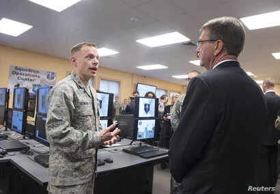 U.S. Defense Secretary Ashton Carter, right, is briefed on the capabilities of the National Guard Cyber Unit at Joint base Lewis-McChord, Washington, March 4, 2016. Carter said the Guard will play an increasingly important role in assessing U.S. vuln...
