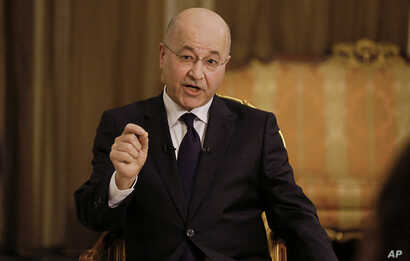 Iraq's President Barham Salih speaks during an interview with The Associated Press in Baghdad, Iraq, March 29, 2019.