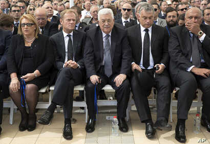 Palestinian President Mahmoud Abbas, center, sits next to European Council President Donald Tusk, second left, during the funeral of former Israeli President Shimon Peres at Mt. Herzl Military Cemetery in Jerusalem, Sept. 30, 2016.