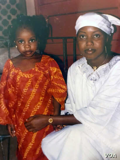 Maya Hughes, left, and Zainab Sesay pose during their time in Sierra Leone. A medical emergency forced Maya to leave the country a month before Zainab. They later reunited in the United States.